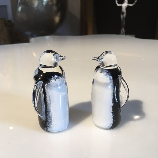 Black and white small glass penguins
