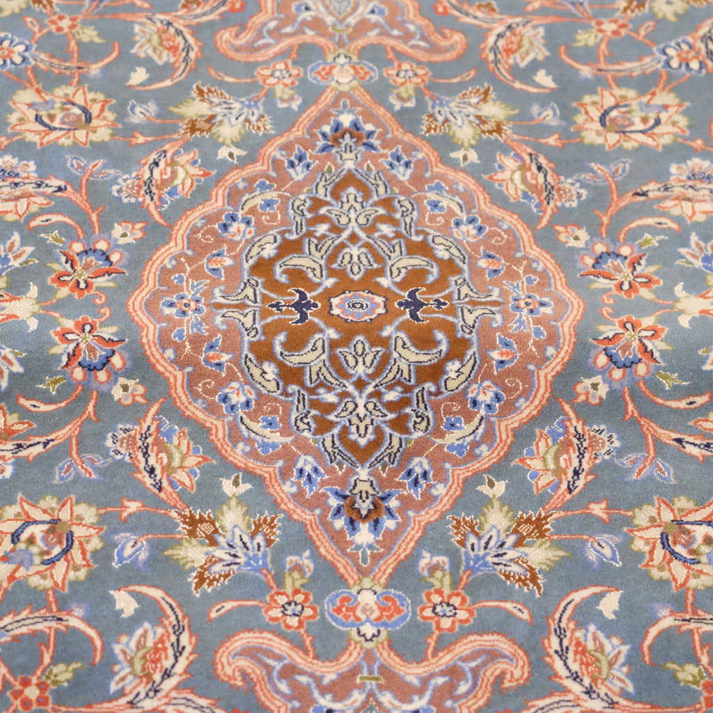 Traditional patterned Persian rug of neutral colours, cream, blue, pink