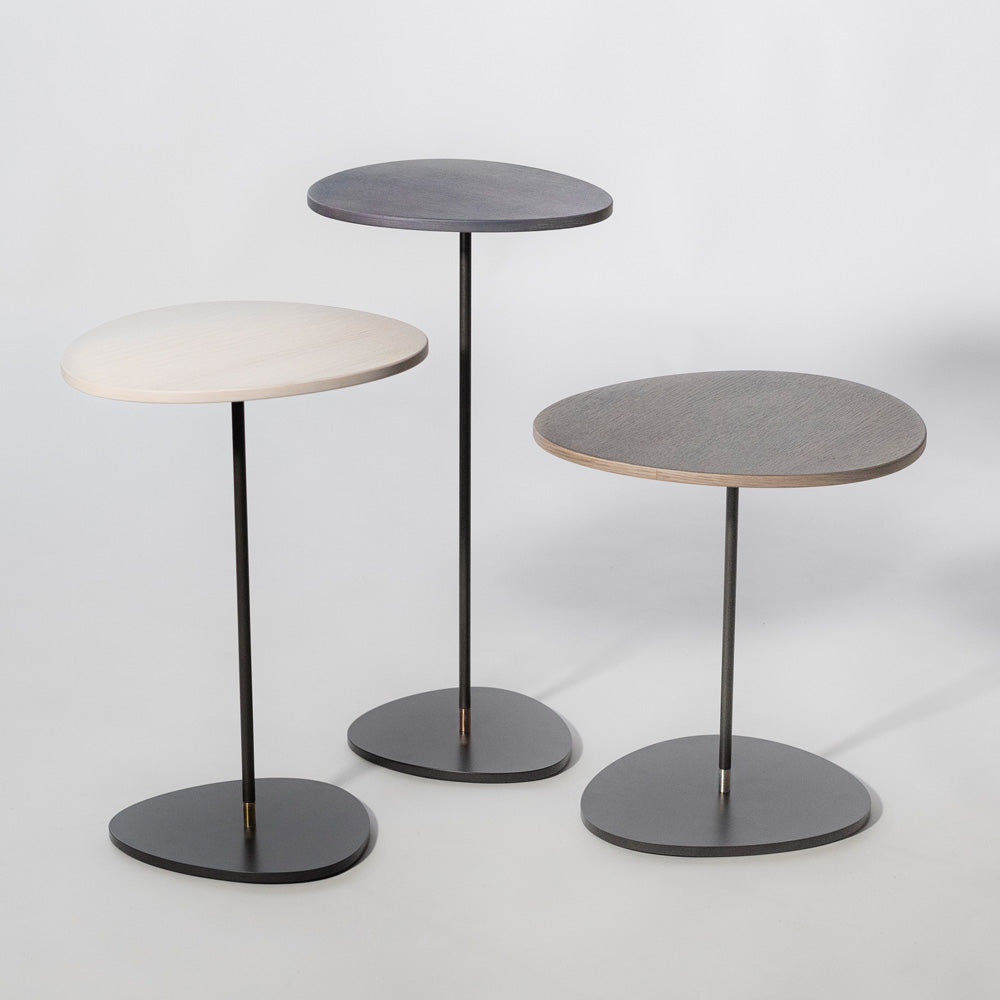 Stem Table by LOOM Furniture with a single stem leg and a rounded top made of wood