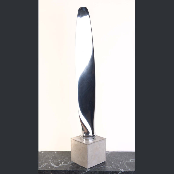 A highly polished aircraft propeller blade from a Piper Apache PA-23-160 twin, standing upright on a plinth.