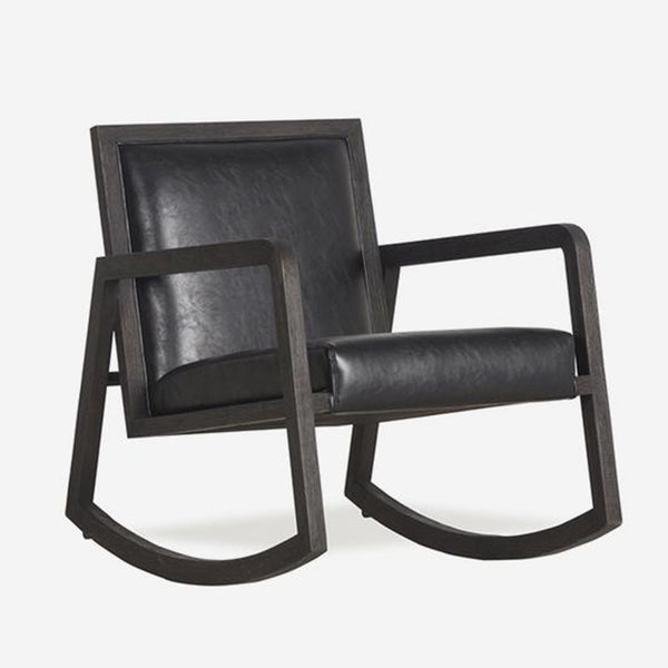 Low rocking arm chair with dark coloured wood and black faux leather