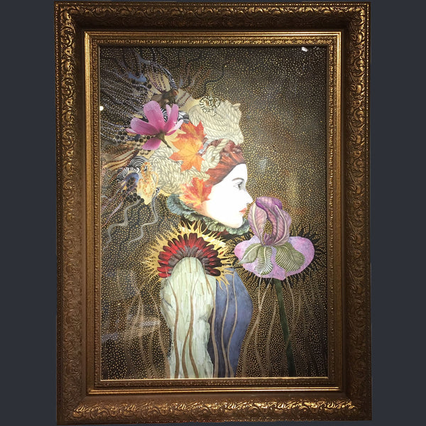 Embellished print in a gold frame of a lady smelling a flower with flowers in her hair by Sabina Pieper