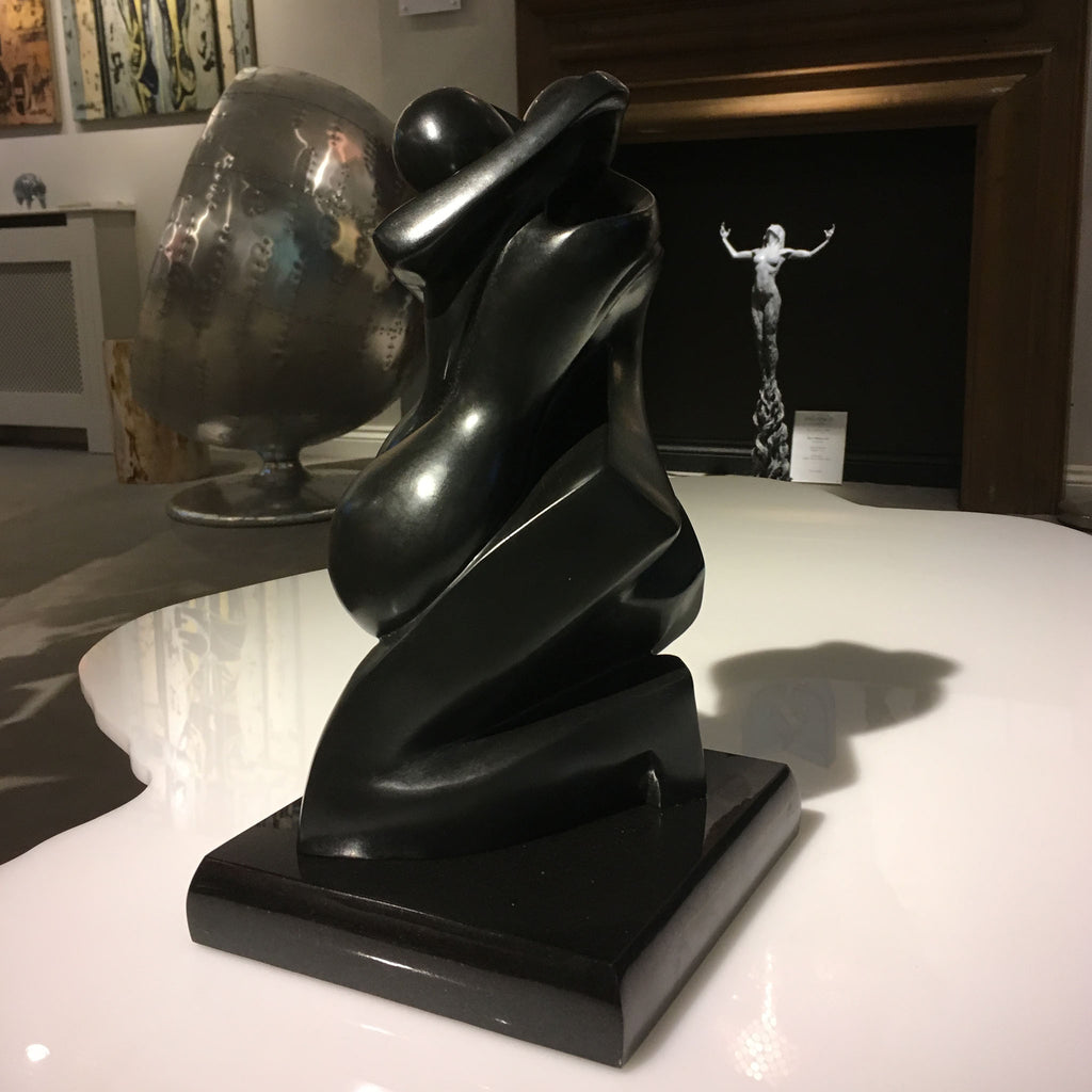 A sculpture of two figures entwined as soulmates by American sculptor, Shray