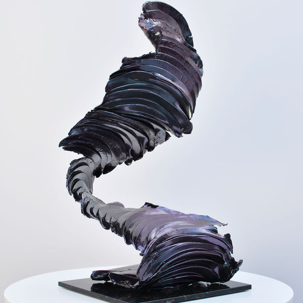 Dark purple/green metallic sculpture like a twist of smoke