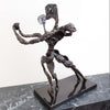 Bronze sculpture of two figures dancing together by Shirley Borokhov