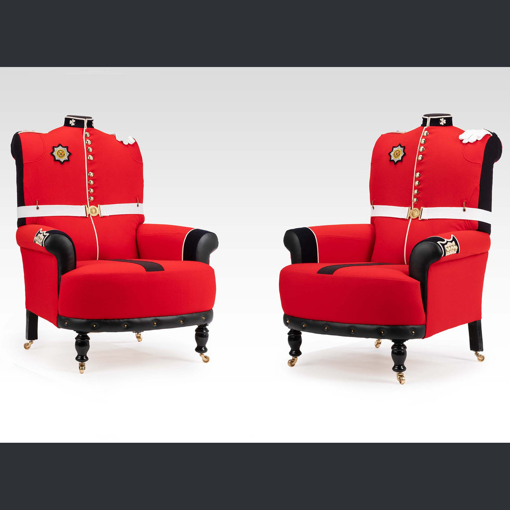 Two arm chairs upholstered with red military uniforms called The Royal Couple by Shaun Brownell