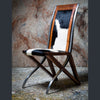 The toro chair made of American black walnut with cow print upholstery
