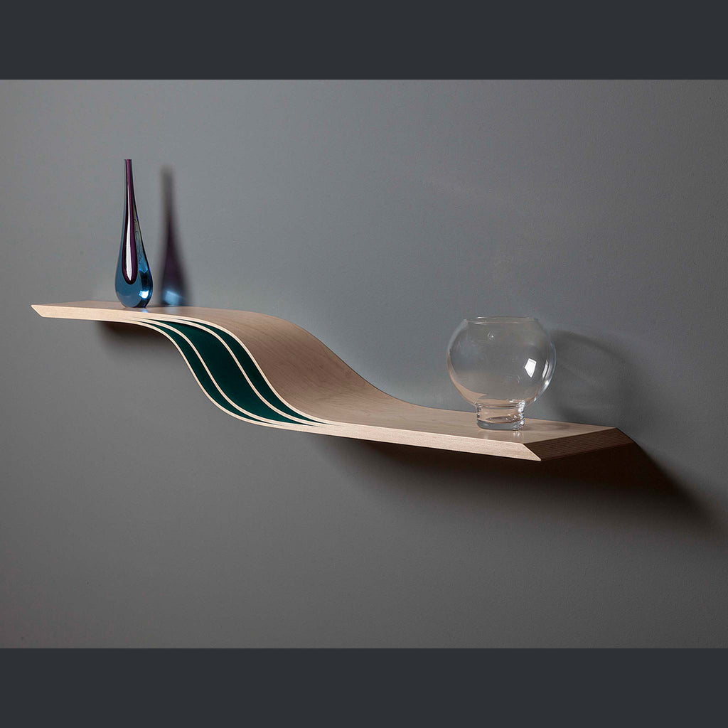 Shelf on two levels in a wave shape with coloured inlays on the curve