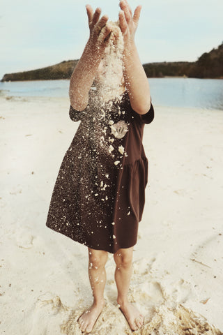 brown dress from lilla design on beach