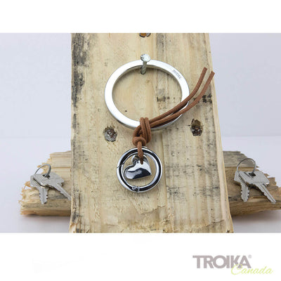 "TROIKA Bag charm ""TEMPTATION"" - silver hanging on wood"