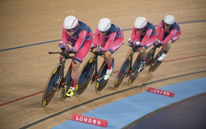 women bike racing track team ride velodrome