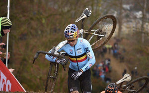 cyclocross bike racer climbs a hill