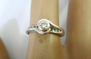 9CT White GOLD, Collet & Channel Set Diamond Ring