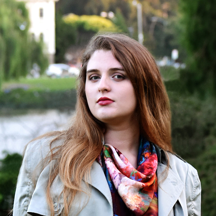 Young woman outdoors with 100% silk scarf made in Italy, designed by Oksana Johnson
