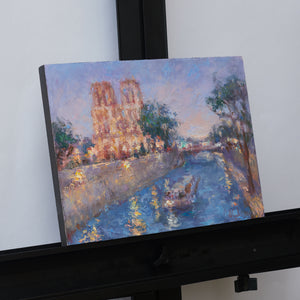 Oksana-Johnson-original-oil-painting-Twilight-in-Paris-9x12-inches-Notre-Dame-Seine-River-boat-on-easel