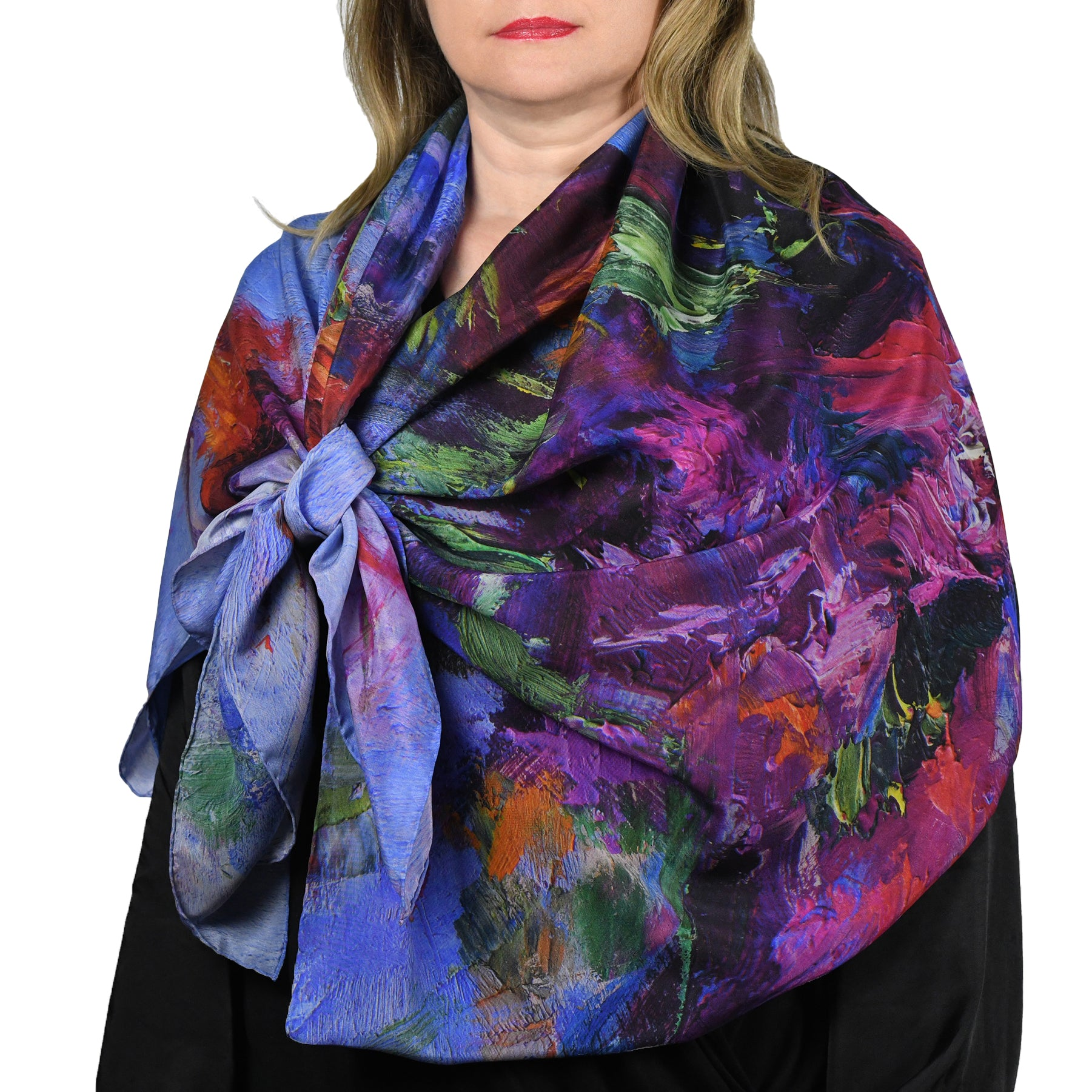 Woman wearing oversized large multi color silk scarf with floral design, Lavender Dream, by Oksana Fine Art and Design (includes blues, purples, oranges, reds, greens).