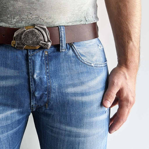 enigma belt buckle on full grain leather brown belt with blue jeans for a casual everyday outfit