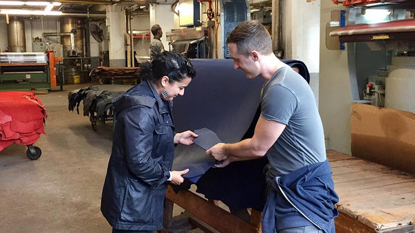 Bryan and Cristina from Obscure Belts inspecting a full grain leather hide at Seidel Tannery