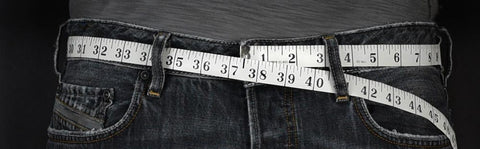 how to measure for a belt cloth tape measure for the perfect size. pull it through the belt loops of blue jeans