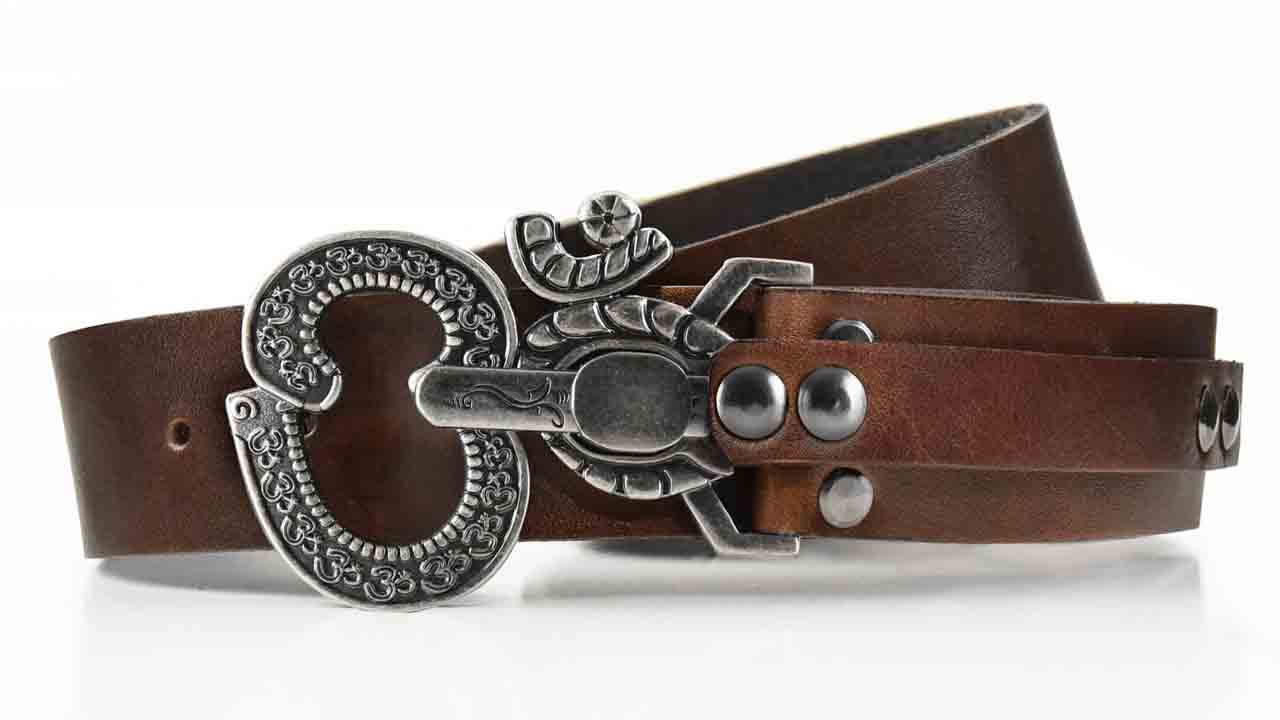 Aged Ohm peace symbol belt buckle. Pull pin to unlock. Brown full grain American leather belt. Womens belt for dress or jeans.