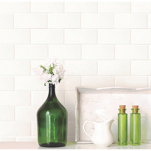 Youtz Paintable Tile Wallpaper-white subway brick tile. hung in kitchen