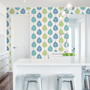 Tsai Multicolor Tree Wallpaper-Stripes of teal, blue and green trees pop against a crisp white background. hung in kitchen