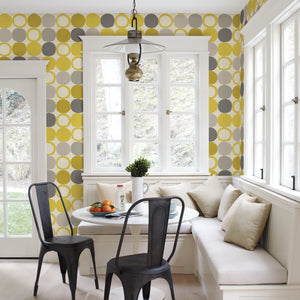 Beard Yellow Geometric Wallpaper-Its textured design features vibrant yellow, taupe and grey circles dancing across a crisp white background. hung in dining area