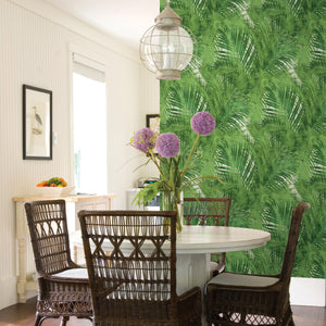 Cora Green Palms Wallpaper-palm print pops against a crisp white background, while its layered effect creates a dimensional look.  hung in dining room