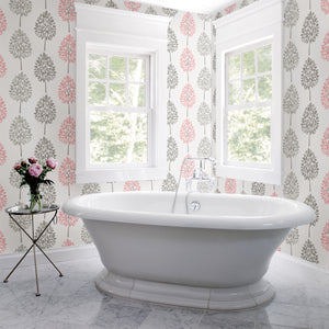 Saar Pink Tree Wallpaper-Stripes of pink and grey trees waltz across an off-white background in this nature inspired print. Their hand painted design lends to a Scandinavian look.  hung in bathroom