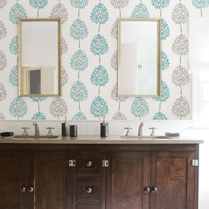 Saar Aqua Tree Wallpaper-hand painted design, this tree wallpaper has a Scandinavian style. Their aqua and light grey leaves pop against an off-white background.  hung in bathroom
