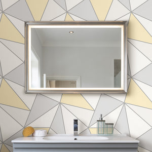 Apex Yellow Geometric Wallpaper-geometric wallpaper. It has white, light yellow and grey triangles which are framed by silver accents.  hung in bathroom