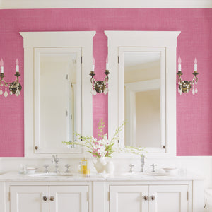 Langston Pink Linen Texture Wallpaper-hot pink wallpaper. Its speckled design creates a linen effect. hung in bathroom over sinks