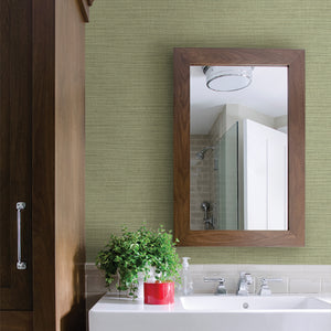 Zora Light Green Linen Texture Wallpaper- Its light green wallpaper has a linen inspired design that softly glimmers with mica details, while raised inks add to its realistic look. Hung on bathroom wall over sink