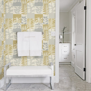 Hammons Gold Block Botanical Wallpaper-features a variety of leaves in gold and silver hues,  Its textured block design is accented by glittering details.   hung in bathroom
