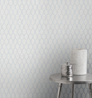 Elodie Light Grey Geometric Wallpaper-A slate geometric dazzles against a light grey background in this contemporary design. Raised inks lend to its fabric inspired look, while distressed accents add a reclaimed flair. hung in living room