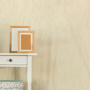 Hartnett Cream Texture Wallpaper-this textured wallpaper has the interplay of gold glitter and a rich cream background