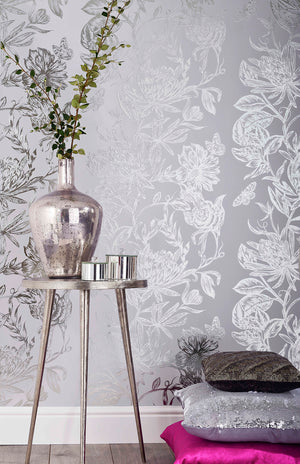 Marquis Grey Floral Wallpaper-brilliant botanical wallpaper features a dazzling floral design. Its silvery pattern effortlessly complements a soft grey background. hung in den