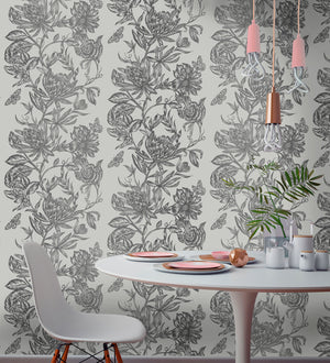 Marquis Grey Floral Wallpaper-brilliant botanical wallpaper features a dazzling floral design. Its silvery pattern effortlessly complements a soft grey background. hung in dining area