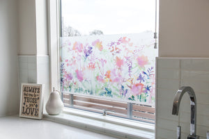 Miraflores Premium Window Film-floral pattern is done in a soft watercolor style. Has various flowers of purple and red shades with green leaves.  Put on bottom half of kitchen sink.