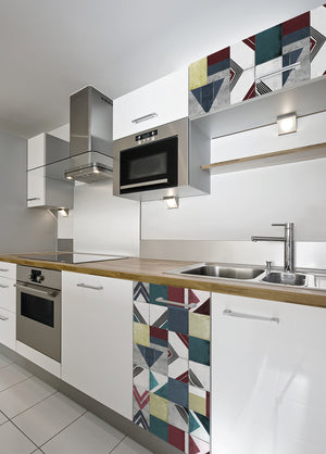 Kopago Adhesive Film-self adhesive vinyl film-geometric pattern has teal, maroon and light yellow hues.  Done on kitchen cupboards.
