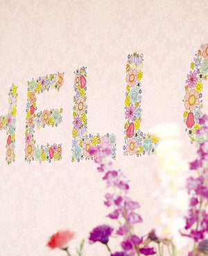 You Had Me At Hello Mural (SKU 359153) The letters are made up of brightly colored flowers, complementing the light pink lacy background.