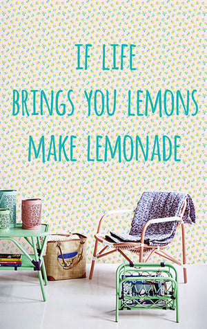 "Lemon Wise Crack Mural-quote printed-if life brings you lemons make lemonade"" is modernized with a pop style lemon print, soft pink background, and large teal lettering.  hung in sitting area"