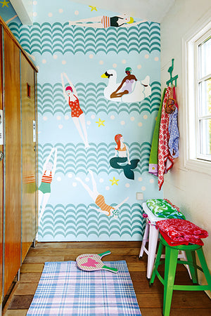 Lovely Ladies Bathing Mural-Mermaids, retro swimmers, and swan floats are the stars of this bright and bubbly mural. Scalloped stripes make up waves. on wall in entryway