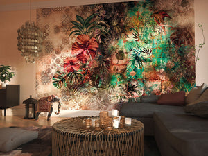 Sherazade Wall Mural-Beautiful red hibiscuses and green palm fronds pop against a beige background. Hung in living room.