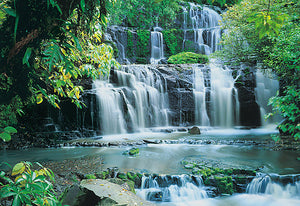 Pura Kaunui Falls Wall Mural-a mesmerizing scene of cascading water, set in a lush forest.