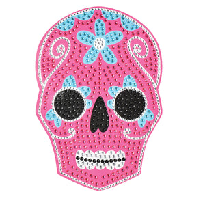 Sugar Skull Bling Art-Its hot pink and blue hues will add a pop of color to your decor, while its rhinestone details will make your wall glimmer.