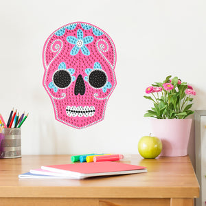 Sugar Skull Bling Art-Its hot pink and blue hues will add a pop of color to your decor, while its rhinestone details will make your wall glimmer.  hung over desk