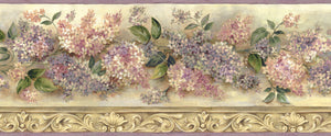 Ethel Sand Heirloom Lilacs Trail Border-Beautiful lilacs in warm purples and pinks are showcased above ornate, faux molding and a wheat-colored background.