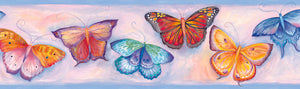 Samantha Blue Butterfly Breeze Trail Border-These butterflies pop off of the wall with these electric, neon butterflies! with a beautiful sunset background of light blue and pink
