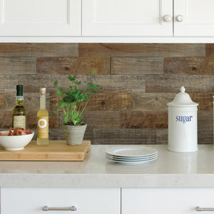 Farm Wood Peel & Stick Backsplash -peel and stick tile  brown wallpaper.  Shown as backspash in kitchen between counter and cupboards.